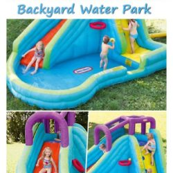 Giant inflated water slide blown up in a backyard of green grass with kids jumping and sliding down while water sprays out of the toy jump house.