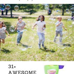 kids running throw bubbles on a nice day in the grass