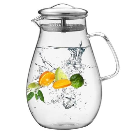 round water pitcher filled with cold water and fresh citrus fruit