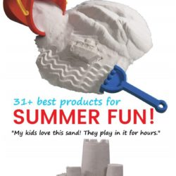 Soft white sand with red bucket and blue shovel. Sandcastle made with soft white sand and kids beach toys.