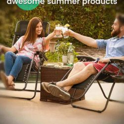 couple sitting on a patio in the summer time holding cheers with glasses in reclining outdoor patio chairs.