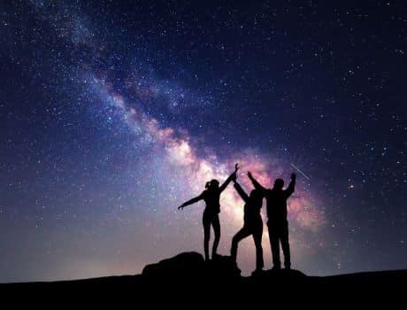 Family stargazing at brilliant sky.