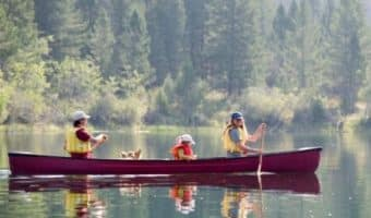 Family fun outdoors in a canoe.