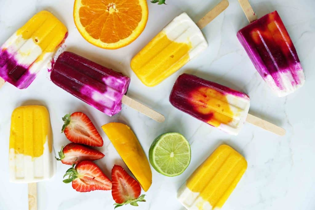 Yummy fruit based popsicles with a variety of colors and flaoros including berries, lemon, lime and orange.