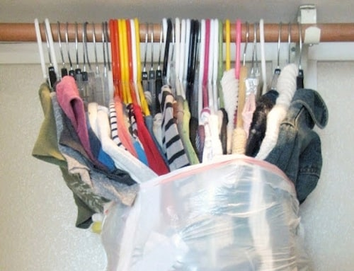 Helpful moving tips - shows garbage bag wrapped around hanging clothes to make moving easier - Listotic Newsletter Feature