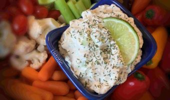 Lime Cucumber Dill Veggie Dip displayed with fresh veggies.