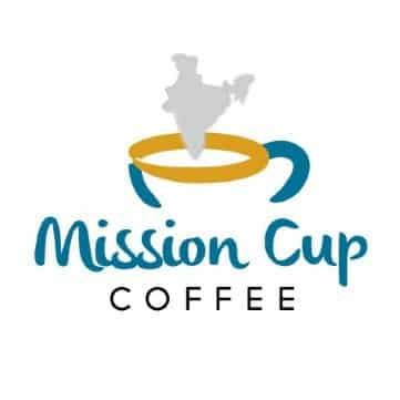 Mission Cup Coffee logo - a cup of coffee with the steam making an image that looks like the country of India. Offering cold brew coffee.