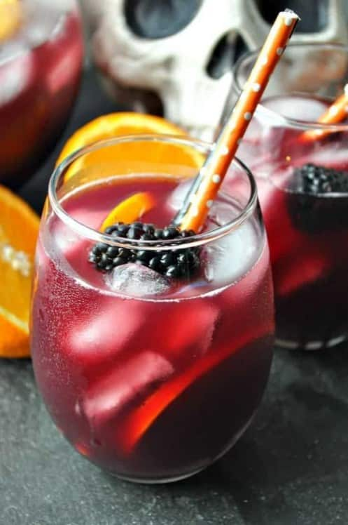 Halloween Inspired Sangria with wine, orange juice, fresh berries for the perfect Hallo-wine drink.