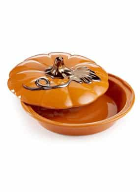 Orange 9 inch round ceramic covered pie dish with stem and leaf on top.