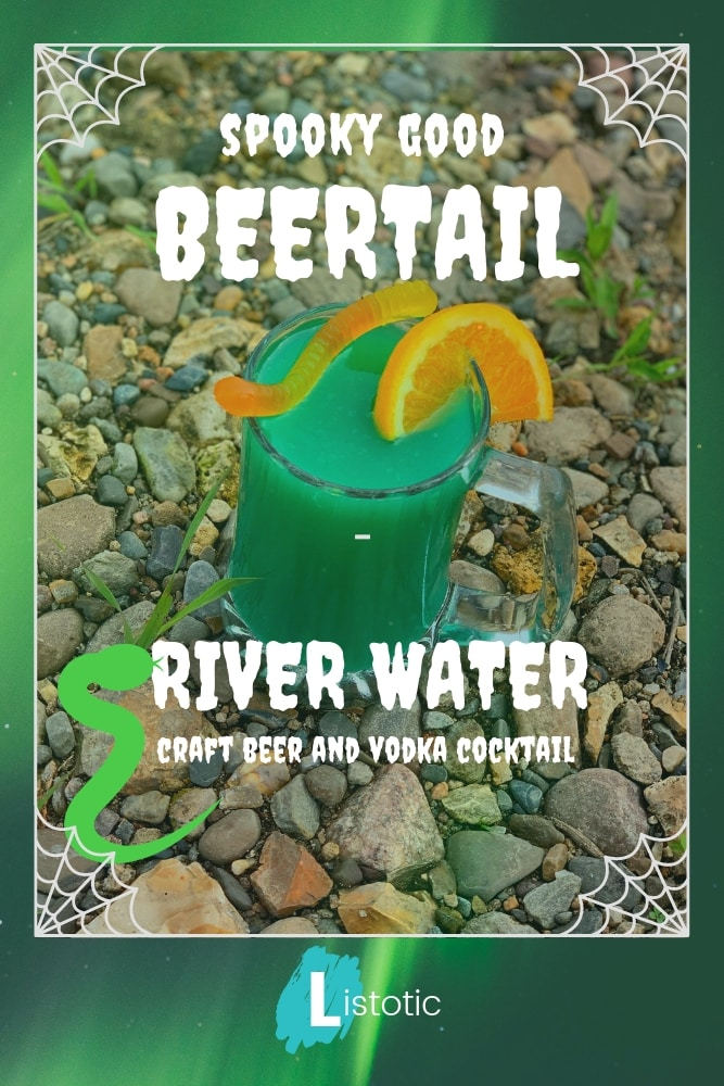 Image of a mug with a beer cocktail inside. Green colored cocktail drink mug resting on river water rocks.