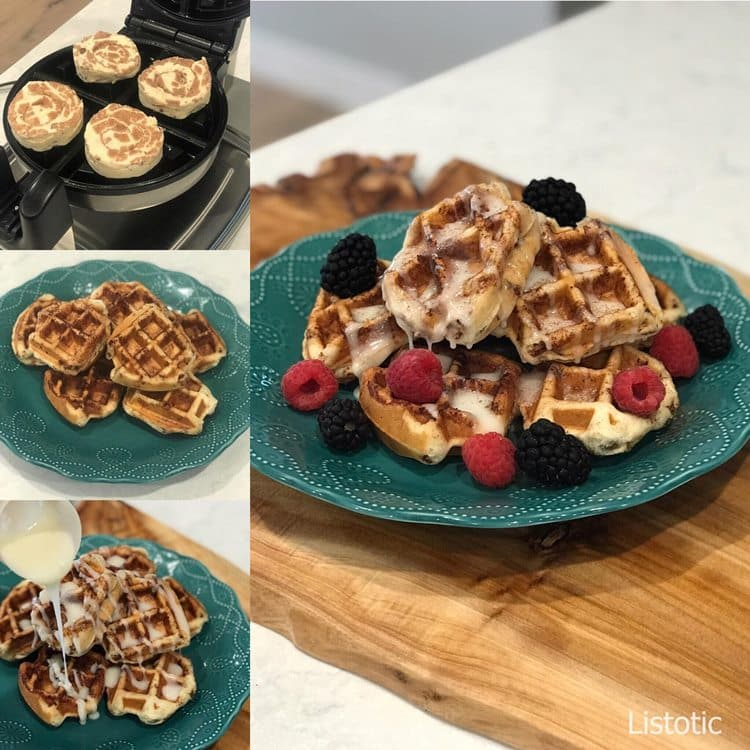 Cinnamon Roll Waffles ready to bake on a hot waffle iron with cinnamon roll waffles on a plate and drizzled with frosting and topped with fresh berries.