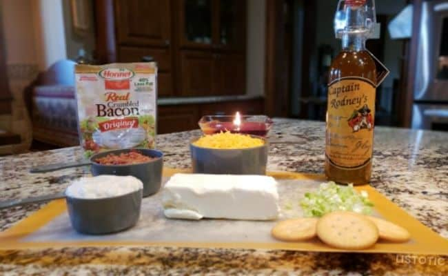 Ingredients for sweet chili cheese dip: cream cheese, bacon bits, cheese, Miracle Whip, green onions and captain Rodney's Boucan Glaze
