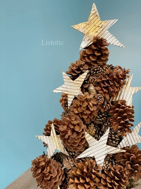Pine cone tree craft sitting on a table