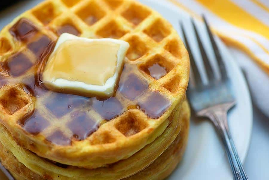 stack of low carb waffles with butter and syrup