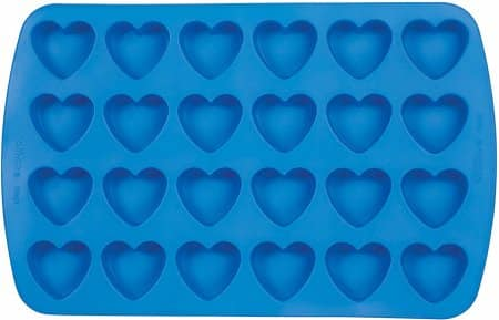 Blue silicone tray with heart shaped molds for baking and crafting