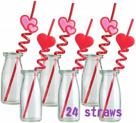 six milk glasses with twisty fun shaped valentine's day straws