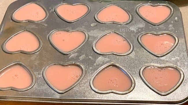 Strawberry Milk poured inside heart shaped molds