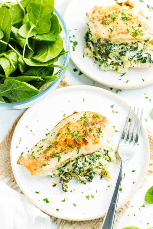Keto-friendly creamy spinach artichoke dip stuffed chicken breast meal.