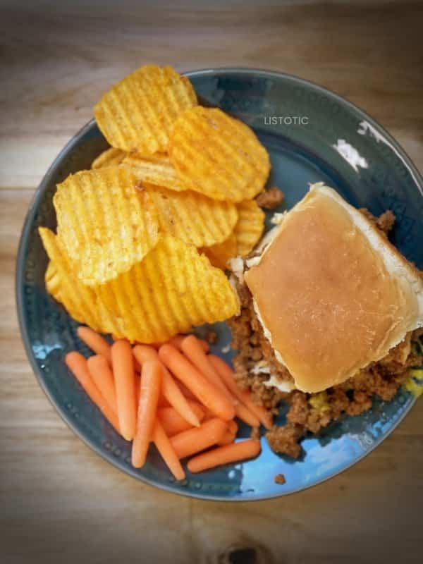 lunch plate with loose meat sandwich carrots and potato chips