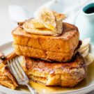 A stack of peanut butter french toast on a plate topped with syrup.