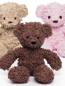 Three teddy bears, one caramel, one brown, and one pink, displayed next to each other.