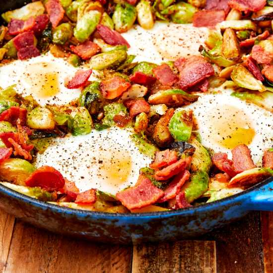 Crispy bacon, flavorful brussel sprouts and eggs make for a bright and colorful dish.