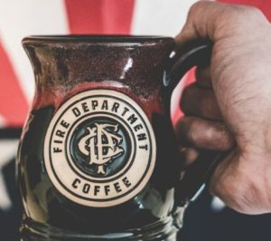 A mug engraved with the Fire Dept. Coffee logo.