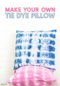 Two tie dye pillows, one blue and one pink, placed on top of each other.