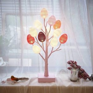 A light up Easter egg tree placed on a table.