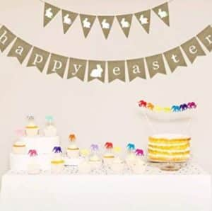 An easter banner hanging above a spread of various desserts.