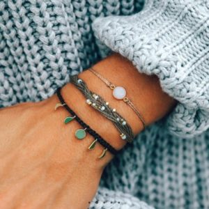Pura Vida handmade bracelets on a person's wrist.