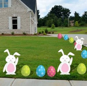 Bunny and egg shaped yard decorations displayed in the lawn.