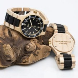 WeWood wooden watches displayed on top of a log.