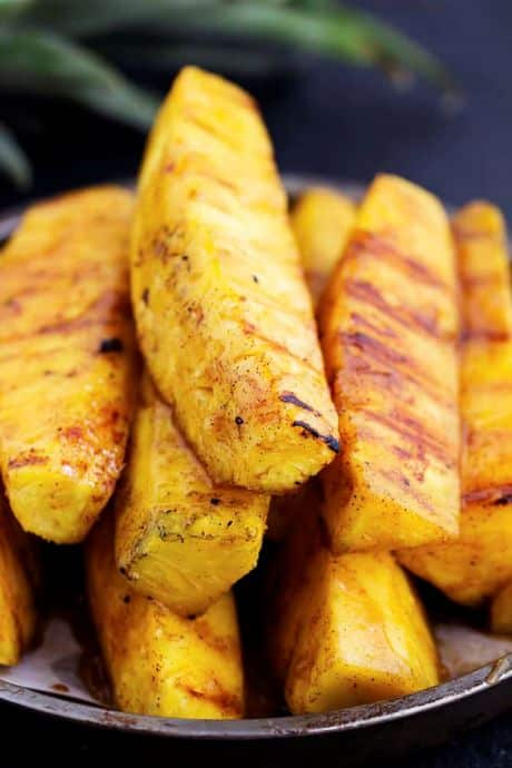 A stack of caramelized brown sugar cinnamon grilled pineapples.
