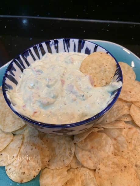A bowl of avocado ranch dip served with tortilla chips.