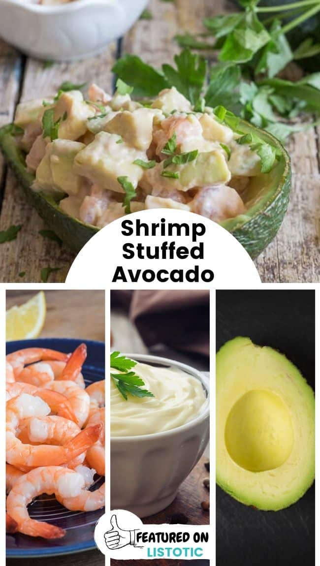A shrimp stuffed avocado laying on a wooden surface.