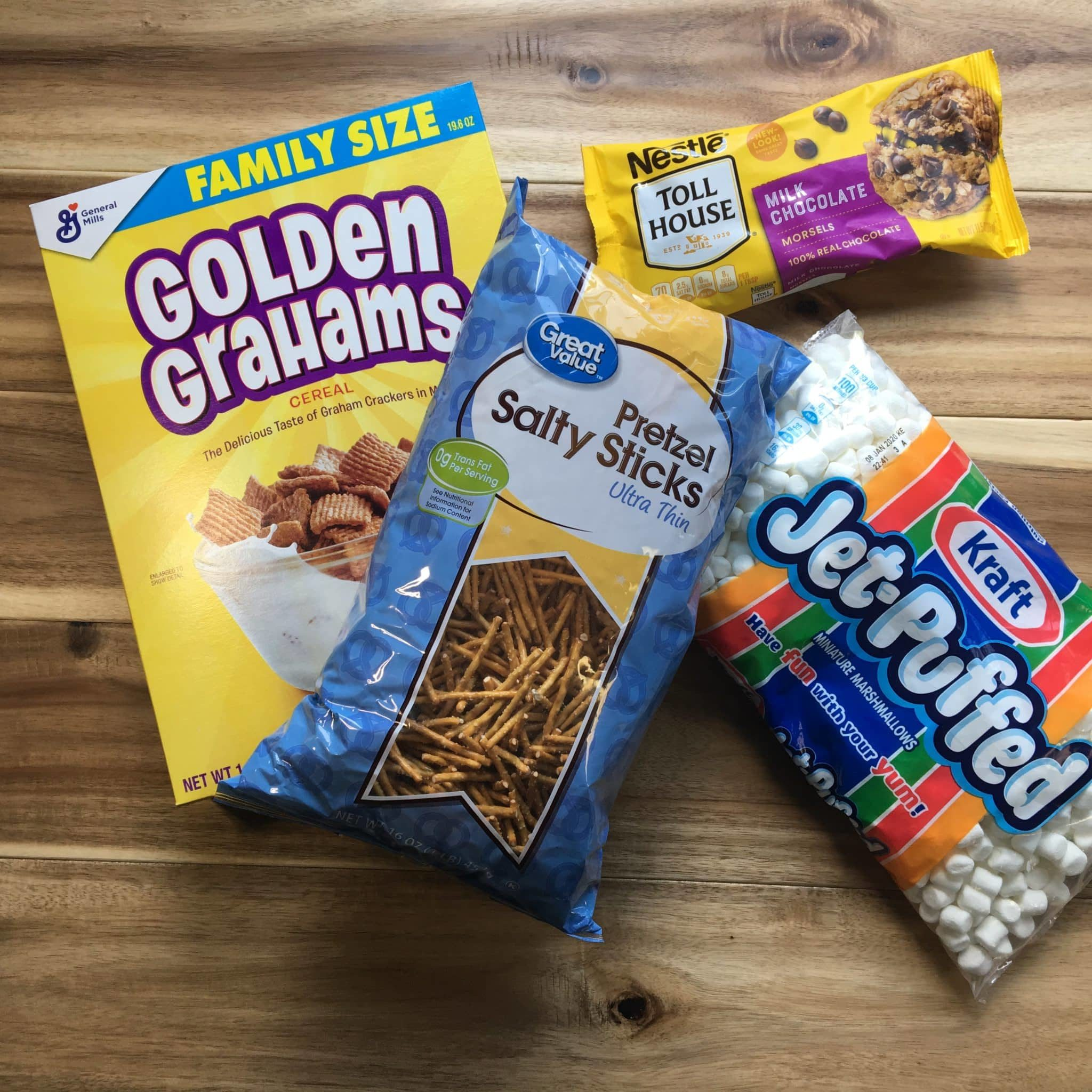 4 ingredient smore snack mix with golden grahams, pretzel, marshmallows and chocolate chips.