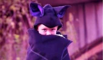 A kid wearing a DIY bat animal costumes for kids.