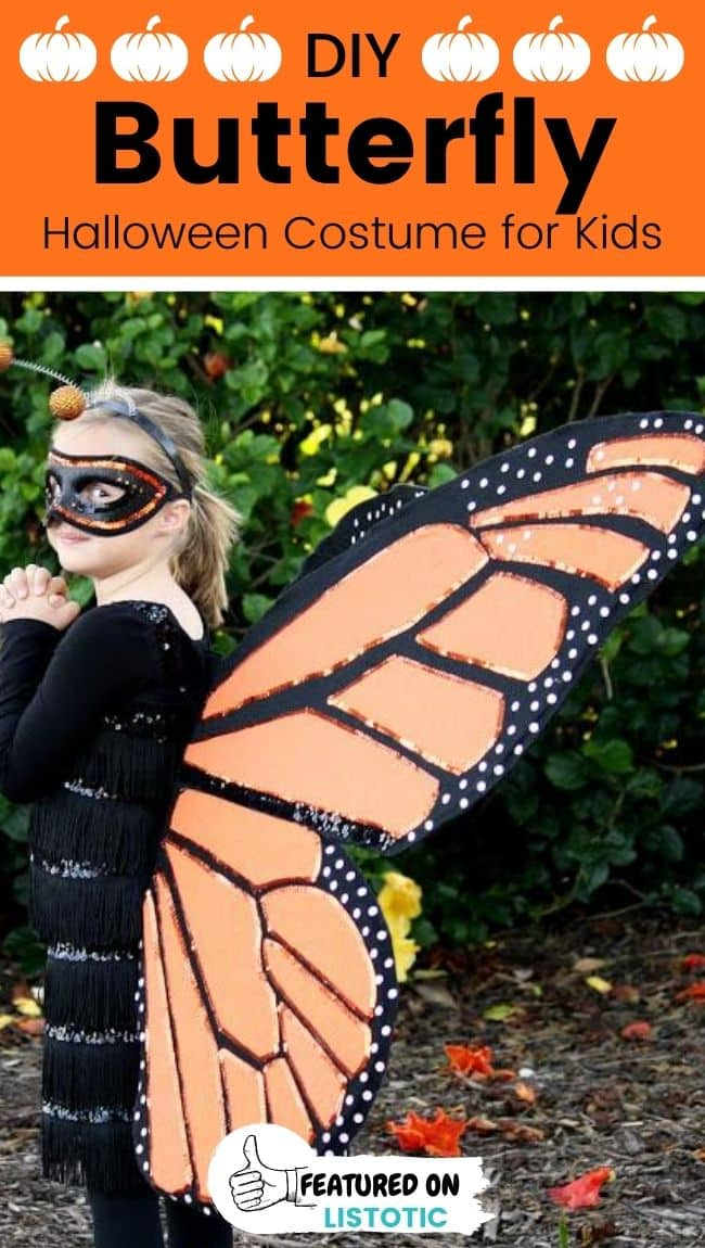 A kid wearing a DIY monarch butterfly Halloween costume.