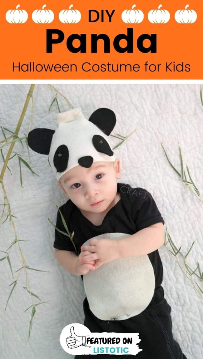 A baby wearing a DIY panda Halloween costume.