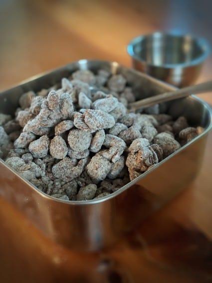 Muddy Buddies Peanut Butter Snack Mix in metal dish