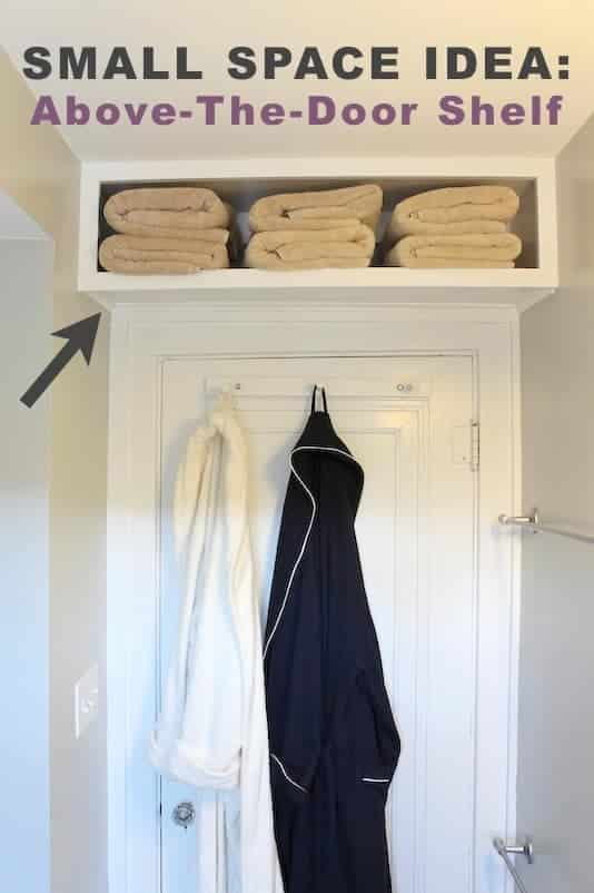 Small space storage solution to use the space above a door for extra storage a built in cabinet open shelf for towels.