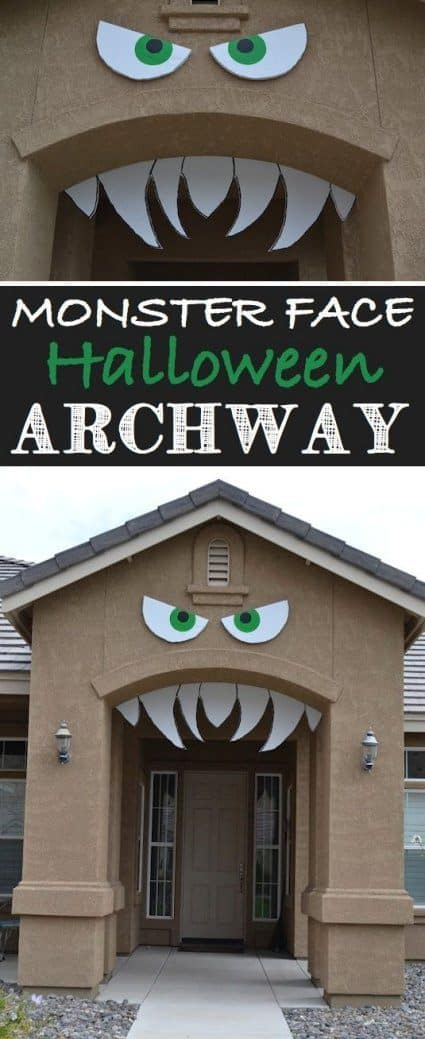 Homemade Halloween Decorations monster face in the archway of a home. Using the fornt door to make a house look like it is a creepy monster with sharp teeth and mean eyes