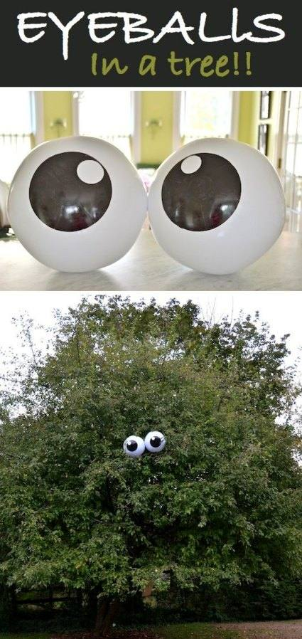giant eye balls in a large tree for creepy Homemade Halloween Decorations.