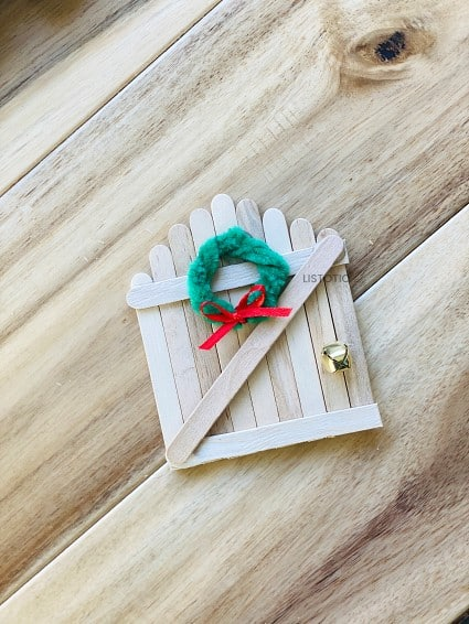 miniature holiday wreath on a magical elf entrance