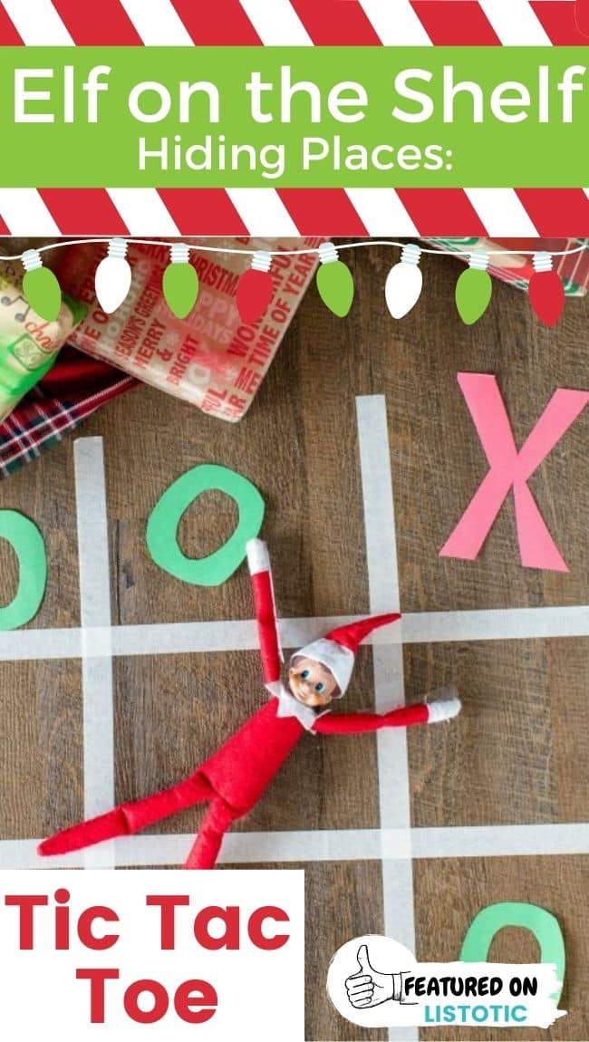 "An Elf on the Shelf doll posing as an ""X"" in a game of tic tac toe."