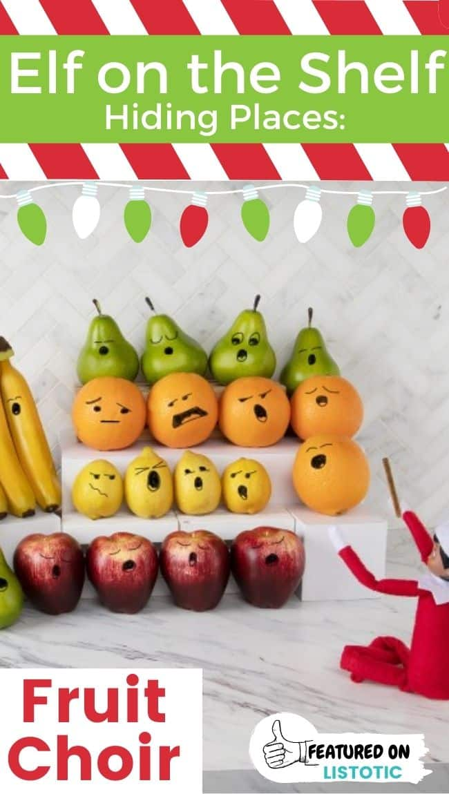 Elf on the Shelf doll conducting a fruit choir.