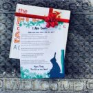 Elf on the shelf arrival letter laying on the front door welcome rug with the Elf on the Shelf book