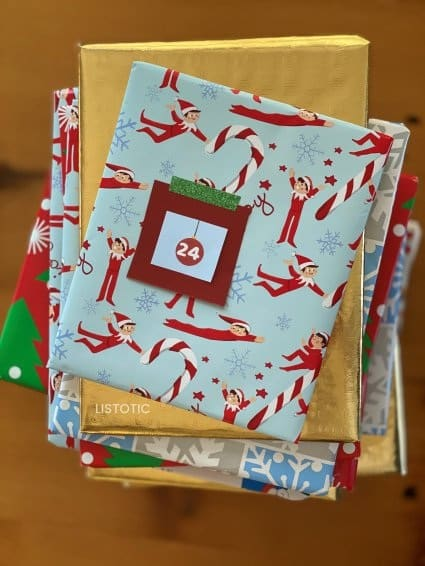stack of books with numbers for a book advent calendar for Christmas elf on the shelf arrival ideas