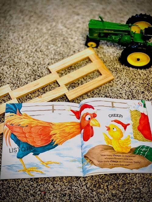 Childerns Counting picture book on the carpet next to farm toys a great book for Christmas Stories read aloud